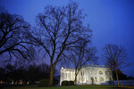 In this Feb. 6, 2020 photo, dusk settles over the White House in Washington. Confronted with trillion-dollar-plus deficits, President Donald Trump is offering a budget plan on Monday that's offering a rehash of previously rejected spending cuts, while keeping a promise to leave Social Security and Medicare benefits untouched. (AP Photo/Patrick Semansky)