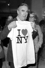 FILE - In this Oct. 9, 1977 file photo, New York Gov. Hugh Carey holds up an