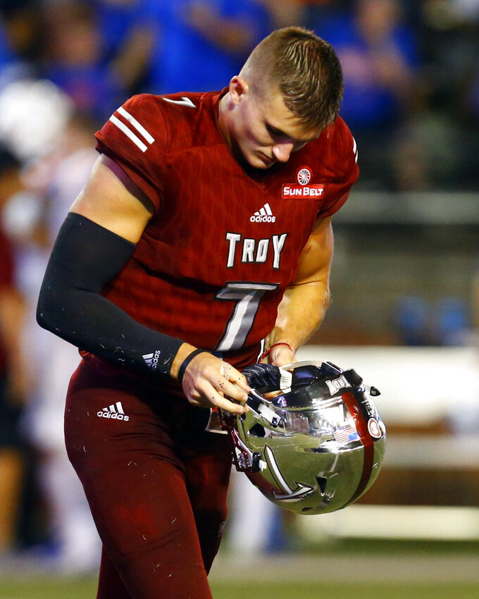 Troy quarterback Kaleb Barker walks off the field  after a fumble was returned for a touchdown by Boise State cornerback Tyler Horton during the second half of an NCAA college football game, Saturday, Sept. 1, 2018, in Troy, Ala. (AP Photo/Butch Dill)