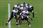 The Atlanta Falcons offensive line is led by Jake Matthews (70) as they stretch during the team's mini camp football practice Tuesday, June 8, 2021, in Flowery Branch, Ga. (AP Photo/John Bazemore)