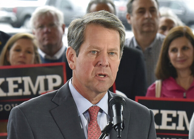 FILE - In this Nov. 5, 2018 file photo, Georgia Republican gubernatorial candidate Brian Kemp speaks a day before Election Day at Peachtree DeKalb Airport in Atlanta. The Georgia attorney general's office says in a newly released report made available Tuesday, March 3, 2020, that an investigation found there was no foundation to Republican Gov. Brian Kemp's allegations that Democrats sought to hack the state's voter registration system before his contentious 2018 election. (Hyosub Shin/Atlanta Journal-Constitution via AP, File)