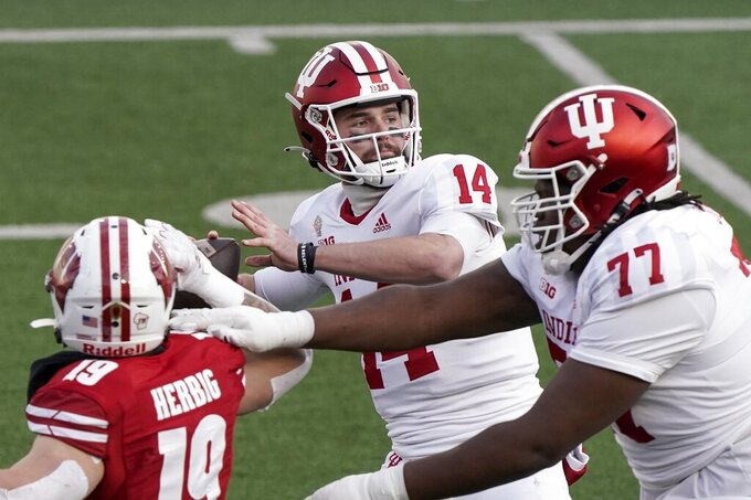 Indiana quarterback Jack Tuttlethrows a pass during the first half of an NCAA college football game against Wisconsin Saturday, Dec. 5, 2020, in Madison, Wis. (AP Photo/Morry Gash)