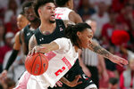 Houston guard Caleb Mills (2) drives around Cincinnati guard Jarron Cumberland, back, during the first half of an NCAA college basketball game Sunday, March 1, 2020, in Houston. (AP Photo/Michael Wyke)