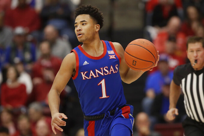 Kansas guard Devon Dotson dribbles upcourt against Stanford during the first half of an NCAA college basketball game in Stanford, Calif., Sunday, Dec. 29, 2019. (AP Photo/Jeff Chiu)