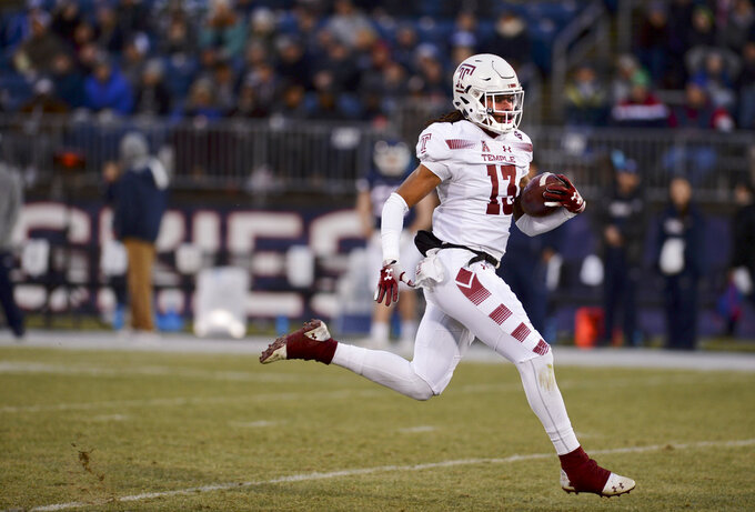 Temple wide receiver Isaiah Wright (13) scores on a 99-yard kickoff return during the first half of an NCAA college football game against Connecticut, Saturday, Nov. 24, 2018, in East Hartford, Conn. (AP Photo/Stephen Dunn)