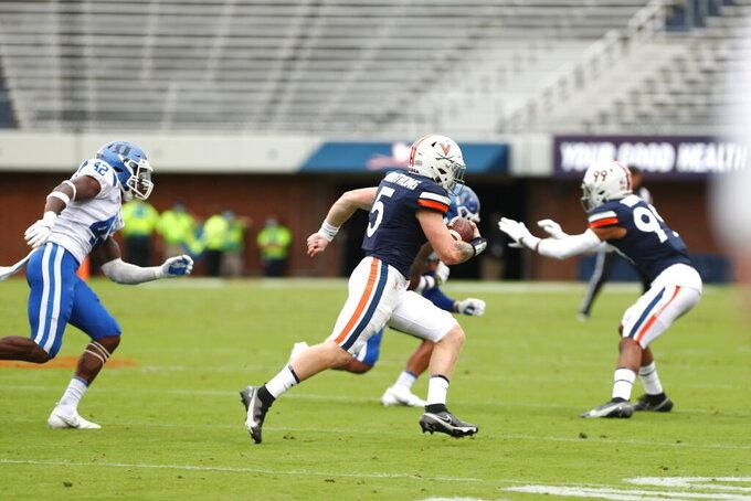 Virginia quarterback Brennan Armstrong (5) runs the ball against Duke during an NCAA college football game Saturday, Sept. 26, 2020, in Charlottesville, Va. (Erin Edgerton/The Daily Progress via AP)