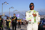 Bubba Wallace participates in the national anthem before a NASCAR Cup Series auto race Sunday, Sept. 6, 2020, in Darlington, S.C. (AP Photo/Chris Carlson)