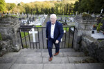 In this photo taken on Wednesday Oct. 16, 2019, Eugene Reavey leaves after visiting the graves of his three brothers in Whitecross in South Armagh, Northern Ireland. Peace is personal for Reavey. He lost three brothers to the conflict in Northern Ireland, which claimed more than 3,500 lives over three decades. (Photo/Peter Morrison)