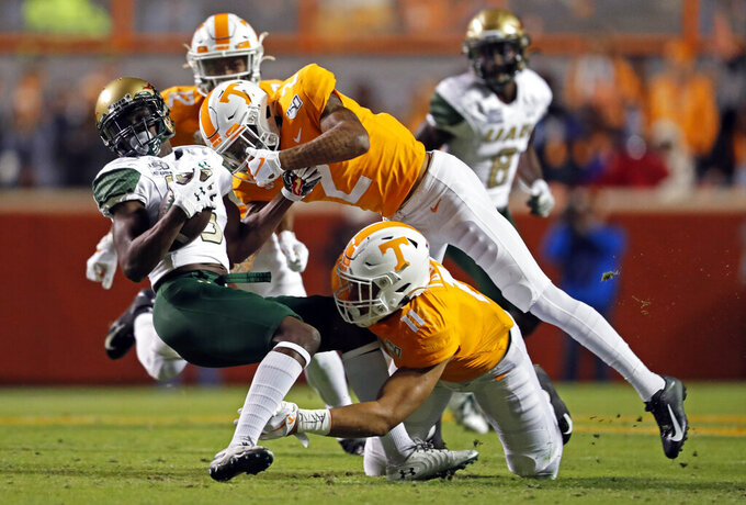 UAB wide receiver Myron Mitchell (5) is tackled by Tennessee defensive back Alontae Taylor (2) and linebacker Henry To'o To'o (11) in the first half of an NCAA college football game, Saturday, Nov. 2, 2019, in Knoxville, Tenn. (AP Photo/Wade Payne)