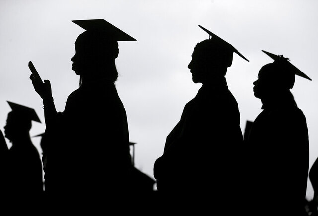 "FILE - In this Thursday, May 17, 2018 file photo, new graduates line up before the start of a community college commencement in East Rutherford, N.J. Scholarship search websites promise students access to millions of awards totaling billions in free money for college. But once you provide your email address, scholarship listings aren't the only things you'll receive. ""[You] are going to get a lot of spam,"" says Monica Matthews, creator of the website how2winscholarships.com. ""You are going to be inundated."" (AP Photo/Seth Wenig)"