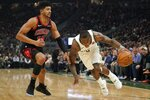 Milwaukee Bucks' Eric Bledsoe drives past Chicago Bulls' Chandler Hutchison during the first half of an NBA basketball game Thursday, Nov. 14, 2019, in Milwaukee. (AP Photo/Morry Gash)