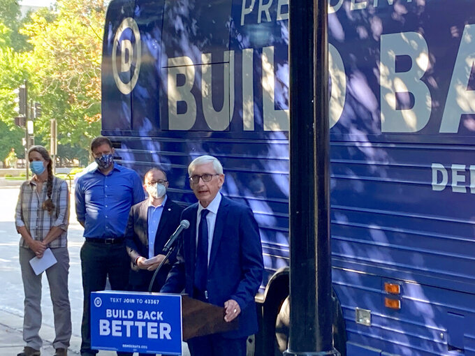 """FILE - In this Aug. 30, 2021 file photo, Wisconsin Democratic Gov. Tony Evers speaks outside the state Capitol in Madison, Wisc. Gov. Evers on Tuesday, Sept. 28, 2021 blasted a Republican-ordered investigation into the 2020 presidential election as a """"$700,000 boondoggle"""" and said election clerks should be """"lawyered up."""" (AP Photo/Scott Bauer File)"""