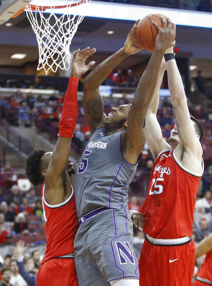 Northwestern's Dererk Pardon, center, tries to shoot between Ohio State's Andre Wesson, left, and Kyle Young during the first half of an NCAA college basketball game Wednesday, Feb. 20, 2019, in Columbus, Ohio. (AP Photo/Jay LaPrete)