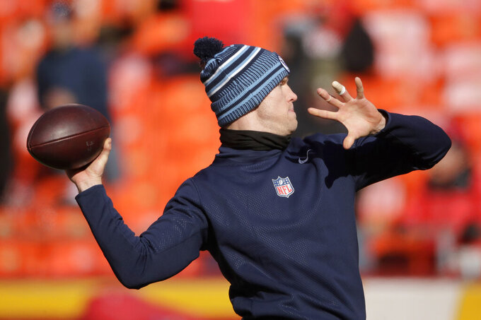 Tennessee Titans quarterback Ryan Tannehill warms up before the NFL AFC Championship football game against the Kansas City Chiefs Sunday, Jan. 19, 2020, in Kansas City, MO. (AP Photo/Charlie Riedel)