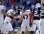 Texas A&M place kicker Seth Small (47) celebrates with Texas A&M holder Nik Constantinou (95) after kicking a field goal during the second half of an NCAA college football game against Auburn on Saturday, Dec. 5, 2020, in Auburn, Ala. (AP Photo/Butch Dill)