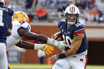 Auburn quarterback Bo Nix (10) eludes a tackle by LSU defensive lineman Ali Gaye (11) as he carries the ball during the second quarter of an NCAA college football game Saturday, Oct. 31, 2020, in Auburn, Ala. (AP Photo/Butch Dill)