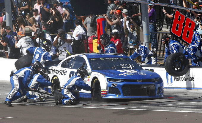 Alex Bowman makes a pit stop during the NASCAR Cup Series auto race at ISM Raceway, Sunday, March 10, 2019, in Avondale, Ariz. (AP Photo/Ralph Freso)