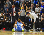 Minnesota Timberwolves center Karl-Anthony Towns and Los Angeles Clippers head coachDoc Rivers, left, react after Towns is fouled as he made a three point shot during the second half of an NBA basketball game Friday, Dec. 13, 2019, in Minneapolis. Clippers won 124-117. (AP Photo/Craig Lassig)
