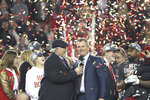 Former NFL player Terry Bradshaw interviews San Francisco 49ers general manager John Lynch during a confetti celebration after the NFL NFC Championship football game against the Green Bay Packers, Sunday, Jan. 19, 2020 in Santa Clara, Calif. The 49ers defeated the Packers 37-20. (Margaret Bowles via AP)