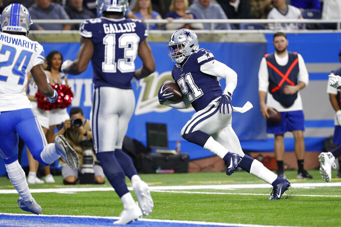Dallas Cowboys running back Ezekiel Elliott (21) runs for a touchdown during the second half of an NFL football game against the Detroit Lions, Sunday, Nov. 17, 2019, in Detroit. (AP Photo/Rick Osentoski)