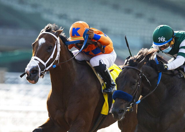 In a photo provided by Benoit Photo, C Z Rocket and jockey Luis Saez, outside, overpower Flagstaff (Victor Espinoza), inside,  to win the Grade II, $200,000 Santa Anita Sprint Championship, Sunday, Sept. 27, 2020 at Santa Anita Park in Arcadia Calif.(Benoit Photo via AP)