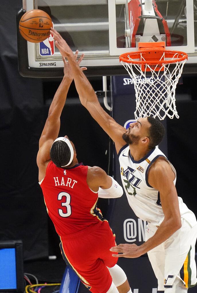 Utah Jazz center Rudy Gobert (27) blocks the shot of New Orleans Pelicans guard Josh Hart (3) during the second half of an NBA basketball game Thursday, Jan. 21, 2021, in Salt Lake City. (AP Photo/Rick Bowmer)