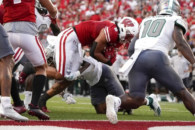 Wisconsin's Chez Mellusi runs for a touchdown during the first half of an NCAA college football game against Eastern Michigan Saturday, Sept. 11, 2021, in Madison, Wis. (AP Photo/Morry Gash)