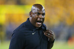 FILE - In this Sept. 21, 2019, file photo, Colorado head coach Mel Tucker reacts to a holding call in the second half during an NCAA college football game against Arizona State, in Tempe, Ariz. A person familiar with the decision says Colorado coach Mel Tucker has agreed to lead Michigan State's football program. The person spoke Wednesday morning, Feb. 12, 2020, to The Associated Press on condition of anonymity because the hiring had not been announced. (AP Photo/Rick Scuteri, File)