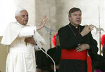 FILE - In this Oct. 12, 2005, file photo, then Pope Benedict XVI, left, and Cardinal George Pell bless the faithful during the weekly general audience in St. Peter's square at the Vatican. Cardinal George Pell was sentenced in an Australian court on Wednesday, March 13, 2019 to 6 years in prison for molesting two choirboys in a Melbourne cathedral more than 20 years ago.  (AP Photo/Gregorio Borgia, File)