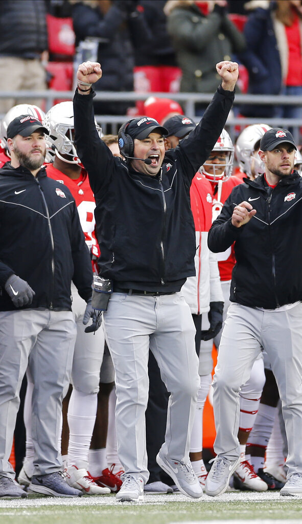 Ohio State head coach Ryan Day celebrates after his team stopped Penn State on fourth down during the second half of an NCAA college football game Saturday, Nov. 23, 2019, in Columbus, Ohio. Ohio State beat Penn State 28-17. (AP Photo/Jay LaPrete)