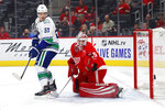 Vancouver Canucks center Bo Horvat (53) and Detroit Red Wings goaltender Jimmy Howard (35) watch the puck bounce off the goal post during the first period of an NHL hockey game Tuesday, Oct. 22, 2019, in Detroit. (AP Photo/Paul Sancya)