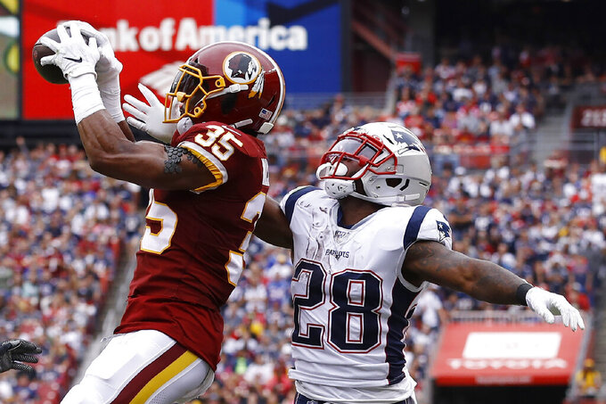 Washington Redskins strong safety Montae Nicholson (35) intercepts the ball ahaed of New England Patriots running back James White (28) during the first half of an NFL football game, Sunday, Oct. 6, 2019, in Washington. (AP Photo/Patrick Semansky)