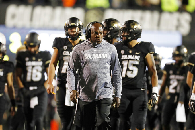 FILE - In this Oct. 25, 2019, file photo, Colorado head coach Mel Tucker watches during the first half of an NCAA college football game in Boulder, Colo. Colorado coach Mel Tucker said he's still committed to the Buffaloes, even after the Michigan State job opened earlier in the week. Michigan State's job came open when Mark Dantonio announced his retirement Tuesday. Tucker was a graduate assistant for the Spartans under Nick Saban in the late 1990s. (AP Photo/David Zalubowski, File)