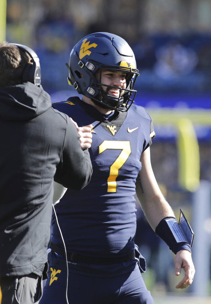 West Virginia quarterback Will Grier (7) celebrate a touchdown during the first half of an NCAA college football game against TCU, Saturday, Nov. 10, 2018, in Morgantown, W.Va. (AP Photo/Raymond Thompson)