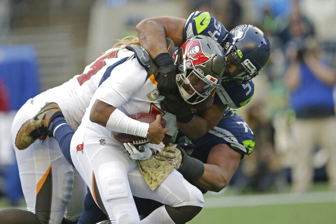 Seattle Seahawks middle linebacker Bobby Wagner, right, sacks Tampa Bay Buccaneers quarterback Jameis Winston during the second half of an NFL football game, Sunday, Nov. 3, 2019, in Seattle. (AP Photo/Scott Eklund)