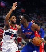 Detroit Pistons guard Reggie Jackson (1) is defended by Washington Wizards guard Chasson Randle (9) during the first half of an NBA basketball game, Monday, Feb. 11, 2019, in Detroit. (AP Photo/Carlos Osorio)
