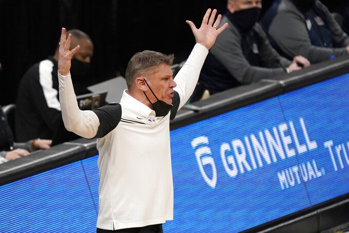 Loyola of Chicago head coach Porter Moser is seen on the sidelines during the first half of an NCAA college basketball game against Indiana State in the semifinal round of the Missouri Valley Conference men's tournament Saturday, March 6, 2021, in St. Louis. (AP Photo/Jeff Roberson)