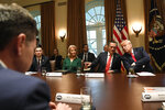 President Donald Trump, right, leans over to talk with Sen. Mitt Romney, R-Utah, second from right, as they listen during a meeting in the Cabinet Room of the White House in Washington, Friday, Nov. 22, 2019, on youth vaping and the electronic cigarette epidemic. K.C. Crosthwaite, Chief Executive Officer of JUUL Labs, left, and White House counselor Kellyanne Conway, third from left also participate. (AP Photo/Susan Walsh)