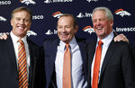 FILE - In this Jan. 14, 2011, file photo, Denver Broncos NFL football team owner Pat Bowlen is flanked by John Elway, left, Executive V.P. of football operations and John Fox, head coach, at the teams headquarters in Englewood, Colo. The late Pat Bowlen will be inducted into the Pro Football Hall of Fame in Canton, Ohio on Aug. 3, 2019.(AP Photo/ Ed Andrieski, File)