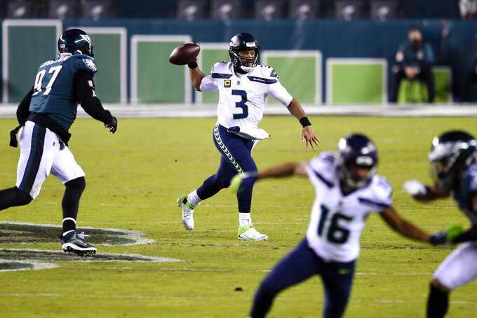 Seattle Seahawks' Russell Wilson plays during the first half of an NFL football game against the Philadelphia Eagles, Monday, Nov. 30, 2020, in Philadelphia. (AP Photo/Derik Hamilton)