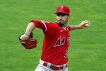 Los Angeles Angels pitcher Andrew Heaney throws to a Minnesota Twins batter during the first inning of a baseball game Thursday, July 22, 2021, in Minneapolis. (AP Photo/Jim Mone)