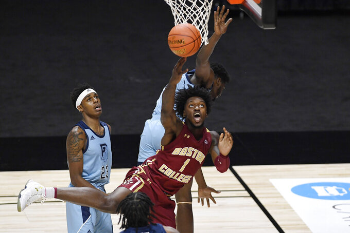 Boston College's CJ Felder (1) is fouled by Rhode Island's Makhel Mitchell, top, in the first half of an NCAA college basketball game, Thursday, Nov. 26, 2020, in Uncasville, Conn. (AP Photo/Jessica Hill)