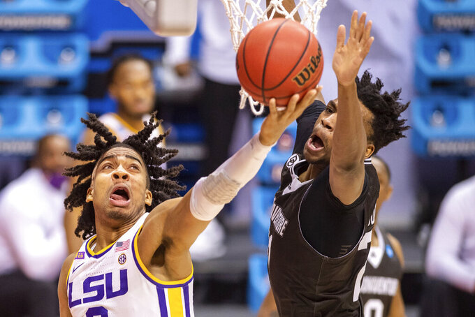 LSU forward Trendon Watford (2) scores with a reverse layup during the second half of a first round game against St. Bonaventure in the NCAA men's college basketball tournament, Saturday, March 20, 2021, at Assembly Hall in Bloomington, Ind. (AP Photo/Doug McSchooler)