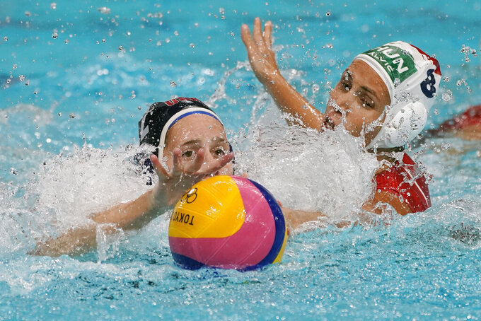 United States' Alys Williams, left, and Hungary's Rita Keszthelyi (8) reach for the ball during a preliminary round women's water polo match at the 2020 Summer Olympics, Wednesday, July 28, 2021, in Tokyo, Japan. (AP Photo/Mark Humphrey)