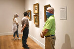 David Dunn, right, security at the Clark Art Institute in Williamstown, Mass. on Sunday, July 12, 2020, surveys the scene as the museum opened to the general public on Sunday with strict protocols in phase three of the state's COVID-19 reopening plan. (Gillian Jones/The Berkshire Eagle via AP)