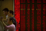 Chinese investors use computer terminals as they monitor stock prices at a brokerage house in Beijing, Friday, May 10, 2019. Asian shares were mostly higher Friday but benchmarks in Shanghai and Hong Kong gave up earlier strong gains amid uncertainty over the potential outcome of trade talks between China and the U.S. (AP Photo/Mark Schiefelbein)