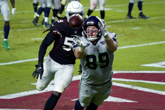 Seattle Seahawks tight end Will Dissly (89) can't pull in a catch in the end zone as Arizona Cardinals outside linebacker De'Vondre Campbell (59) defends during the second half of an NFL football game, Sunday, Oct. 25, 2020, in Glendale, Ariz. (AP Photo/Rick Scuteri)