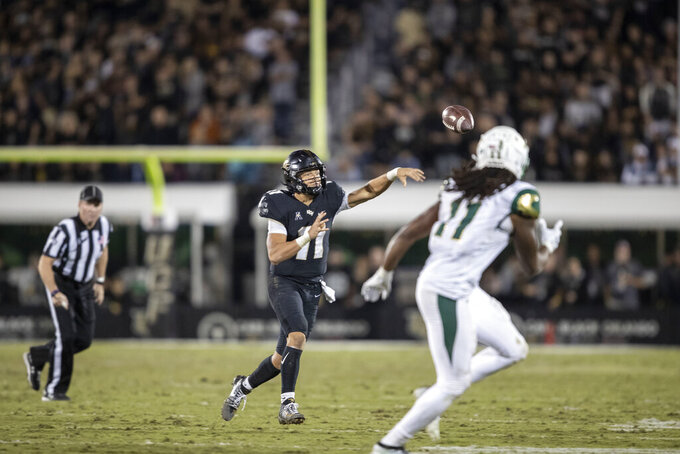 Central Florida quarterback Dillon Gabriel (11) throws a short pass during the first half of the team's NCAA college football game against South Florida, Friday, Nov. 29, 2019, in Orlando, Fla. (AP Photo/Willie J. Allen Jr.)