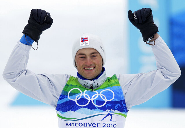 FILE - In this Feb. 28, 2010, file photo, Norway's Petter Northug celebrates winning the gold medal during the flower ceremony of the Men's 50k mass start classic Cross Country race at the Vancouver 2010 Olympics in Whistler, British Columbia, Canada. Northug has admitted to possessing cocaine, speeding and driving under the influence. On Monday, Aug. 17, 2020, prosecutor Silje Haugerstuen Bergsholm told Norwegian news agency NTB that Northug is facing preliminary charges for speeding for driving 168 kph in a 110 kph zone, driving while under the influence of a substance and possession of narcotics. (AP Photo/Dmitry Lovetsky)