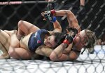 Paige Vanzant, right, punches Rachael Ostovich during the second round of a women's flyweight mixed martial arts bout at UFC Fight Night Saturday, Jan. 19, 2019, in New York. Vanzant stopped Ostovich in the second round. (AP Photo/Frank Franklin II)